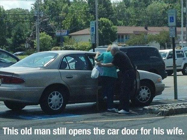old man holds car door open for his wife