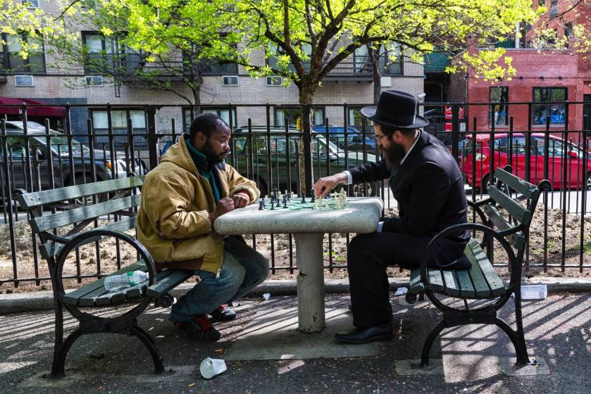 two men play chess in NYC
