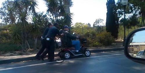Two Cops Push a Wheelchair-Bound Veteran all the way Home.