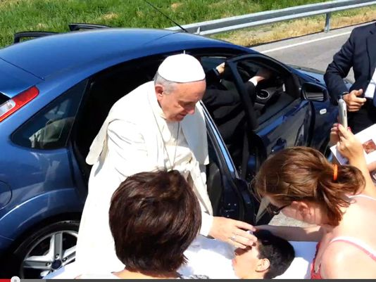 Pope Francis has his Car Stopped and Gets out to bless a Disabled Woman