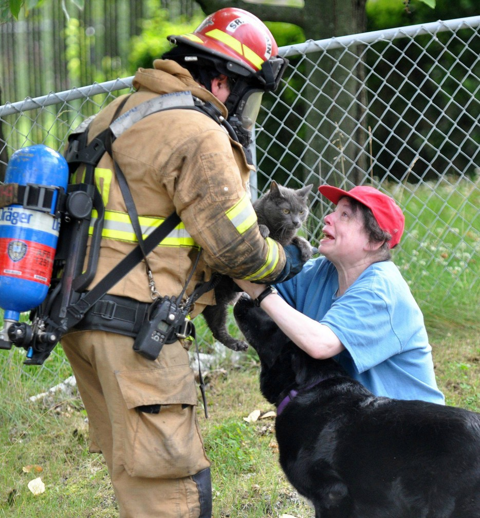 The firefighter who risked his life to save a woman's frightened cat..jpg