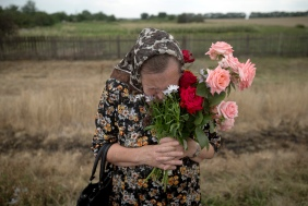 A local woman praying at the MH17 crash site, Donetsk oblast, Ukraine [3000x2019]