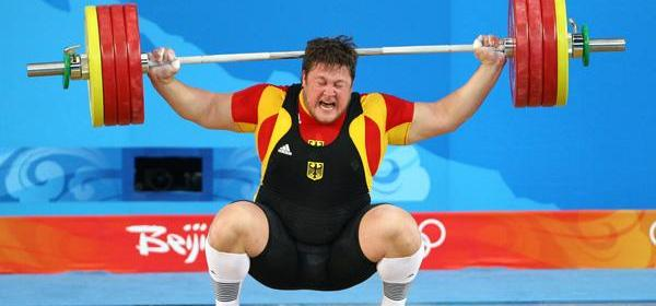 Matthias Steiner of Germany attempts a lift during the Men's 105 kg group weightlifting event.
