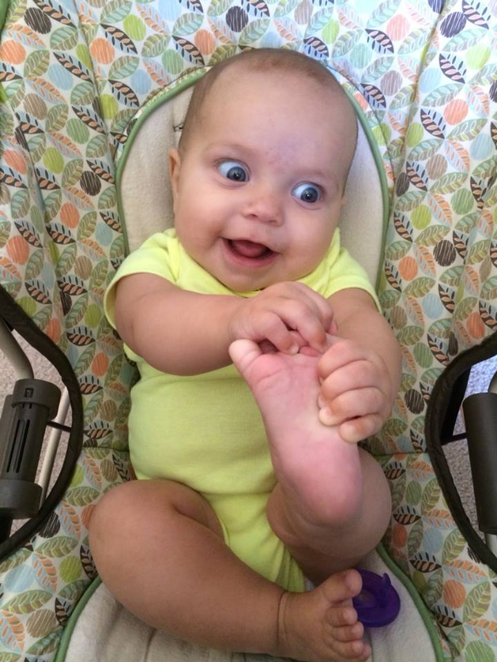 A friend's newly born daughter discovering her foot.