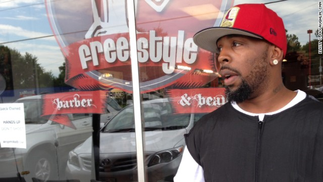 Mike Knox has been staying at his barbershop until 4 a.m during the Ferguson protests to ward off looters