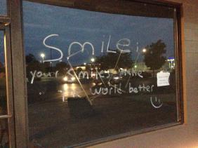 written on a window - smile