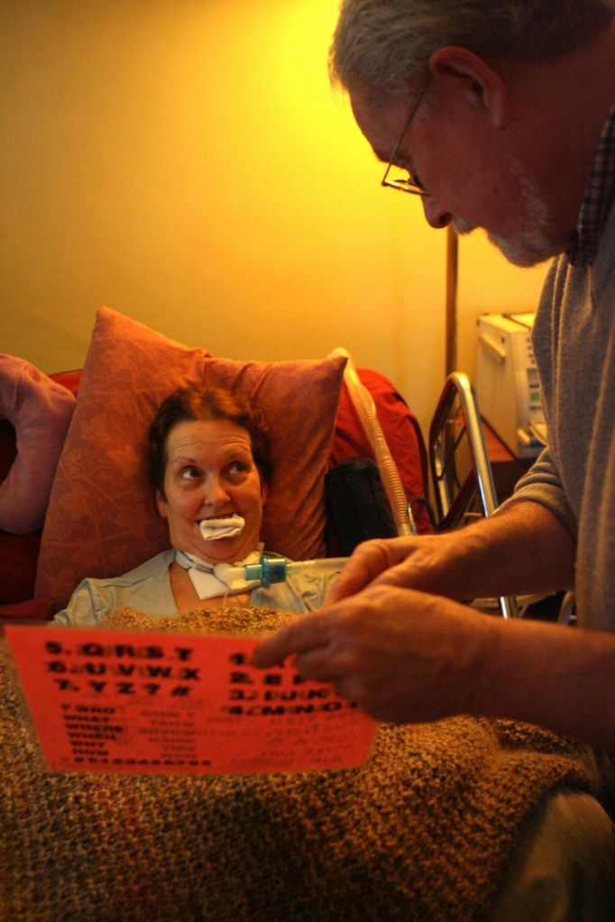 Lois V. Schultz((cq)) communicates with her husband Sam Ashworth((cq)) through letters, numbers and words on a sheet of paper. Lois((cq)) moves her eyes to let him know he is correct. Staff photo by Nick Daggy