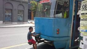 This little dude was snapped dude hitching a ride on the back of a tram. Sarajevo 2014.