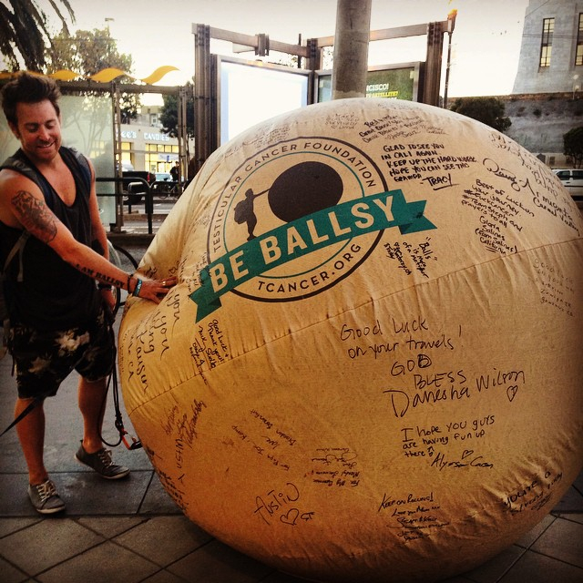 This Man is Pushing a 6-foot Inflatable Testicle Across ...