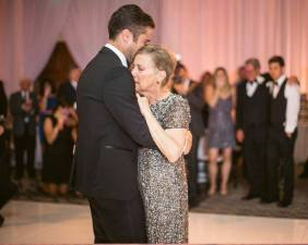 Ryan Manning dancing with his mother