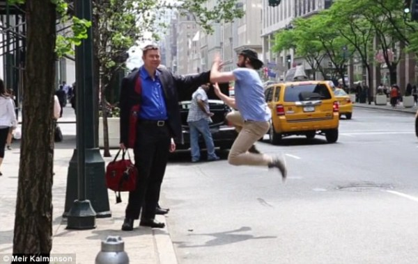 This Happy New Yorker Shares The Love, One High-Five At A Time