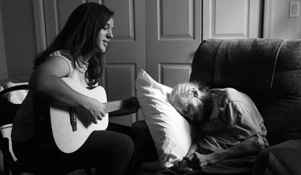 "Rose Vuolo and her music therapist, Ms. Burton. ""When Charla is playing,"" said her grandson, Paul Motisi, ""my grandmother appears to be somewhat lucid. Her emotions go into a much more positive space."""