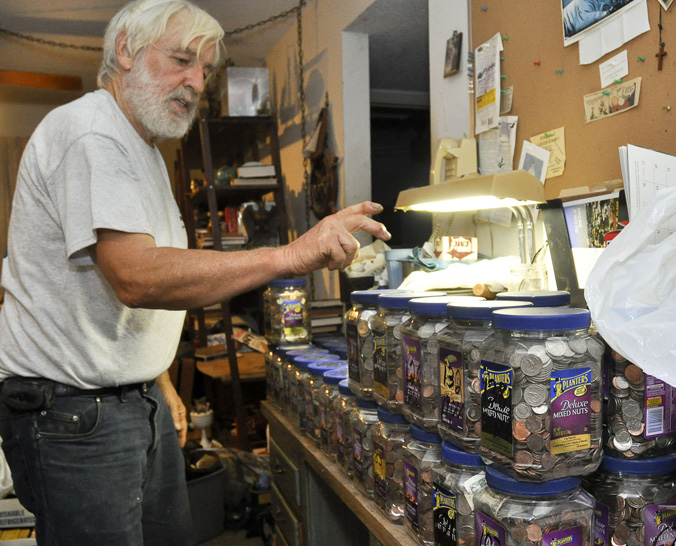 Man's Donates His $20K Spare Change Collection