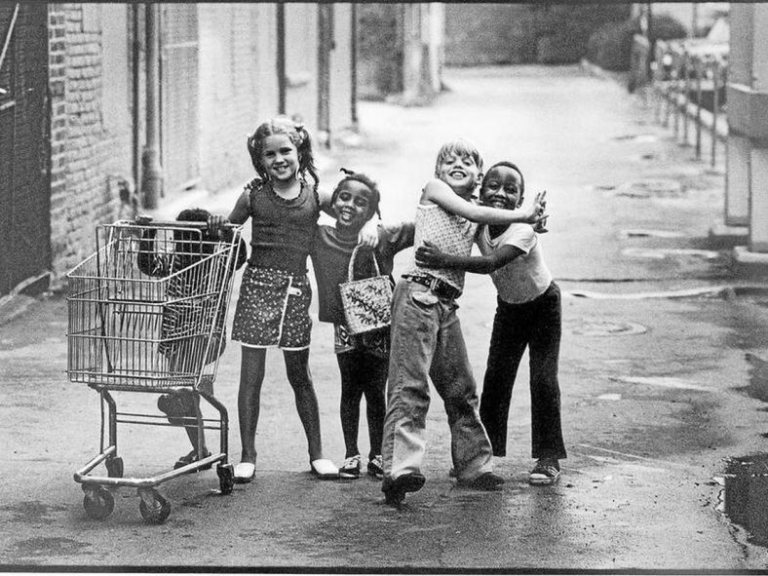 five young friends in a rain-washed alley in downtown Mount Clemens