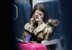 woman crying on a train