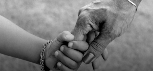 mother holding hands