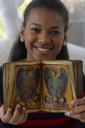 Nubia Wilson, 16, of Antioch, holds a 17th century Ethiopian Orthodox manuscript at her home in Antioch, Calif., on Sunday, Jan. 11, 2015. (Jose Carlos Fajardo/Bay Area News Group