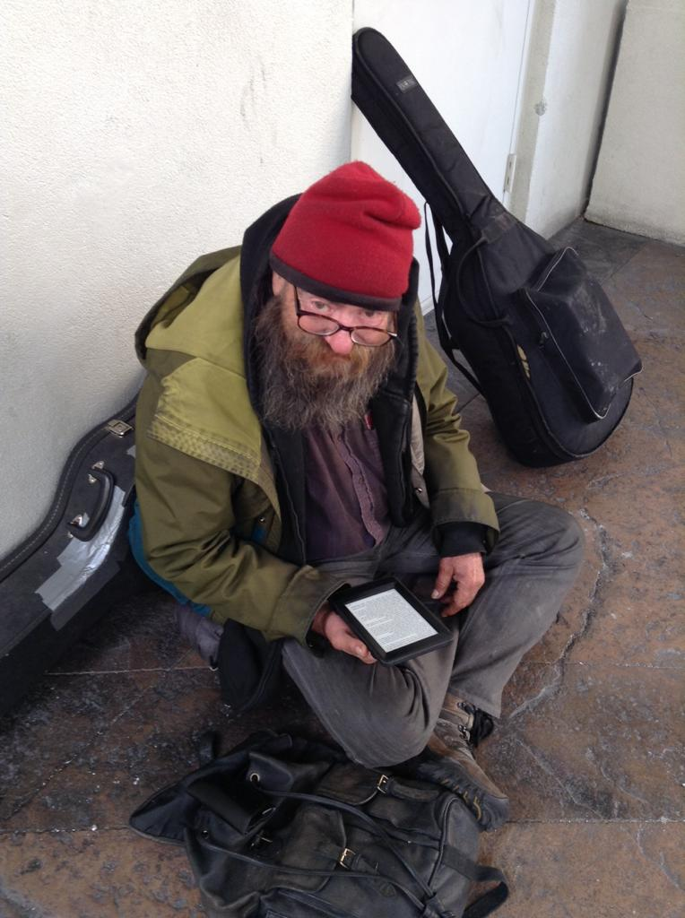 homeless man with a kindle