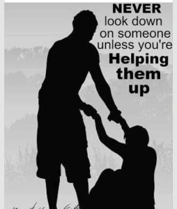 Silouette of A Person Helping Up Another Person