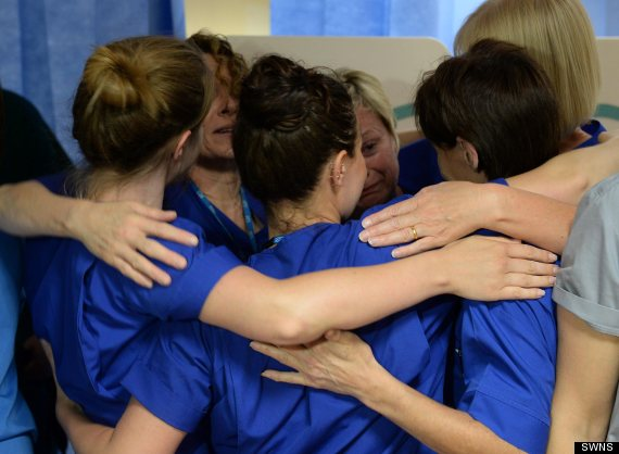 Hospital workers shed a few tears as the Accident and Emergency ward at Frenchay Hospital, Bristol is closed down. See SWNS story SWNURSE: This is the moment a group of nurses broke down in tears after an historic A&E unit in the city the hit series Casualty is filmed in, shut down. Matrons at the Accident and Emergency department at Frenchay Hospital, Bristol, finished their final shift in the early hours of Monday (19/5) morning. After more than 50 years in action the unit closed it's doors for the final time, with all ambulances being diverted a new department. Nurses left heartfelt messages with felt-tip pens on the heavy hospital doors and released balloons to say goodbye to the ward.