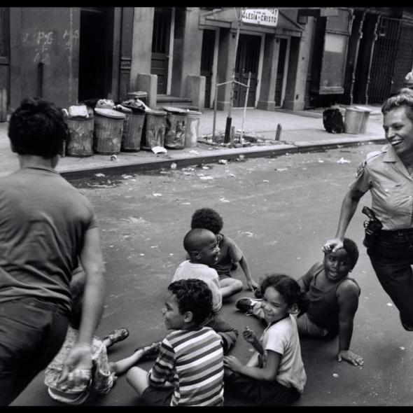 Police officers playing with children in Harlem, 1978