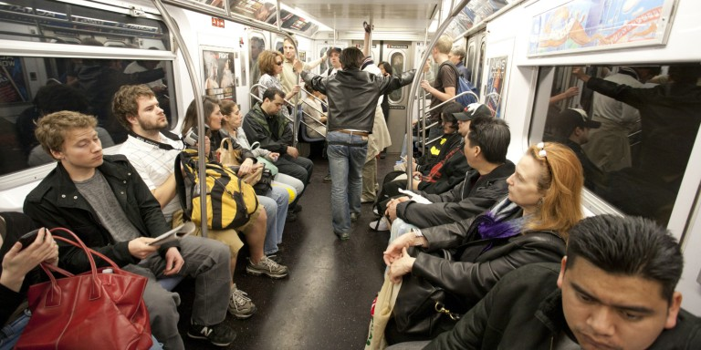 NYC Subway commuters ride the train