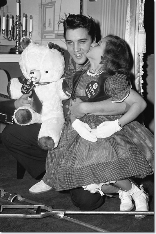 Elvis with a young polio patient 1958