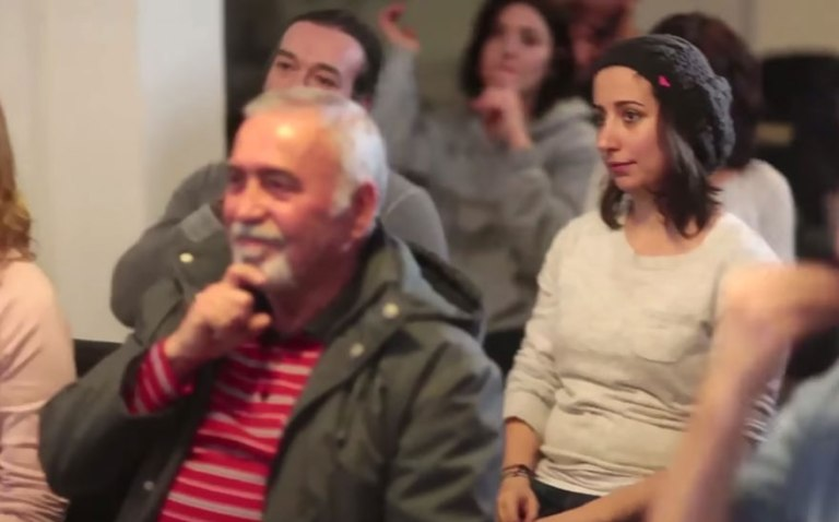 """Muharrem's neighbors spent a month secretly learning sign language Hidden cameras were placed throughout his neighborhood One day, Muharrem, a deaf man living in Istanbul, and his sister Ozlem headed out for a walk… …and were greeted with an unexpected """"good morning"""" – in sign language! The local baker was in on it too, offering bagels in sign language This man at the grocer's dropped his oranges and when Muharrem and Ozlem picked them up for him… …he offers them each an apple – in sign language Muharrem's confused – why is everyone signing? Et tu, taxi driver? This man is confused, but his sister knows what's up As they head to the town square, the team prepares for the finale He's surrounded by his signing neighbors! His reaction says it all! This goes to show how important it is to break down communication barriers… …and how meaningful that can be for people who experience those barriers every day"""
