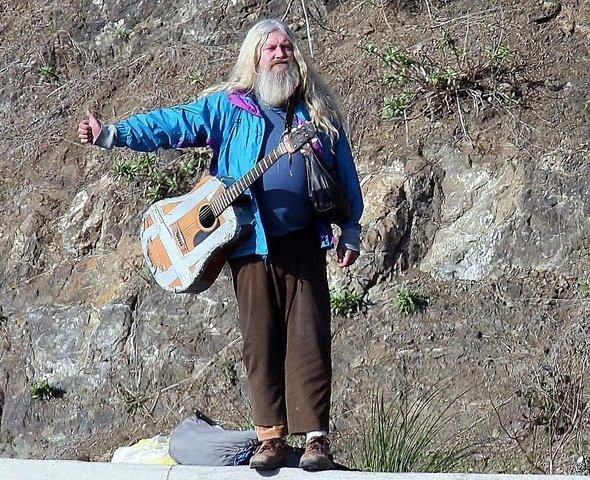 old man hitchhiking