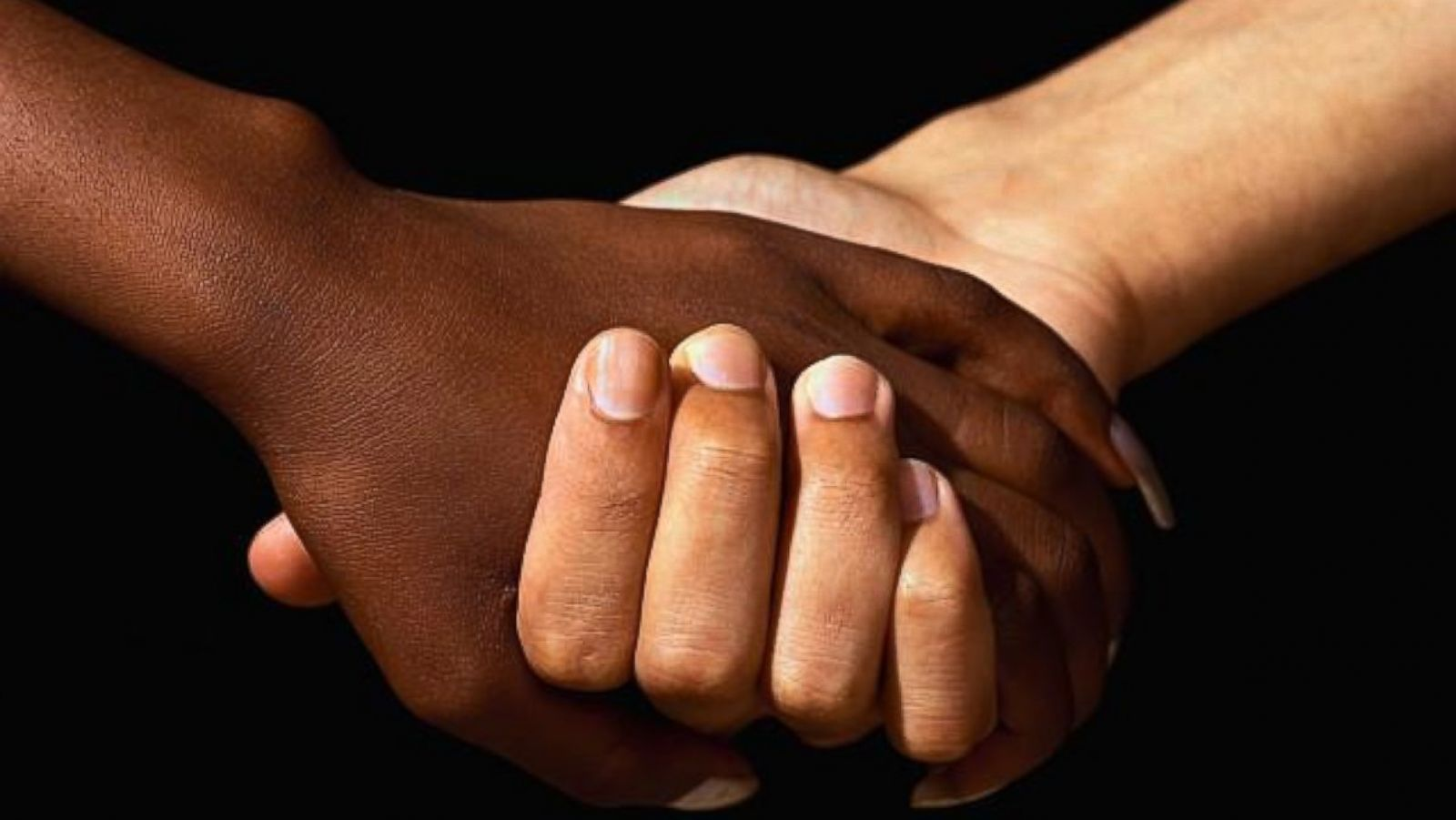 racism holding hands