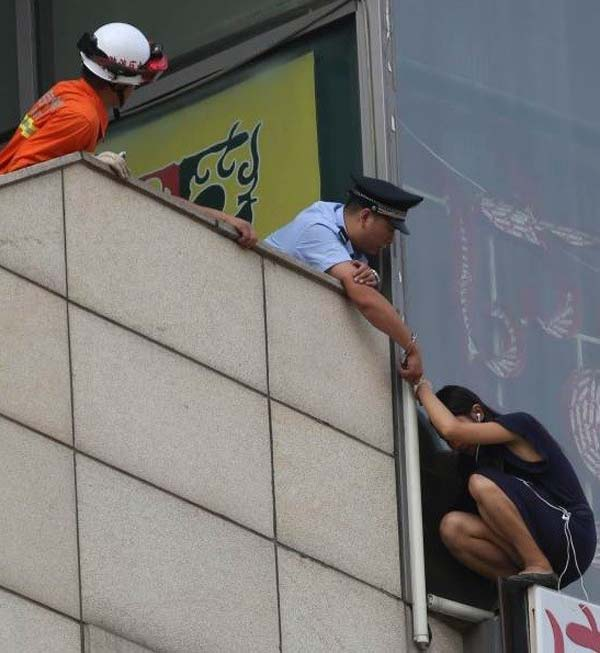 A brave police officer handcuffed himself to a woman who was trying to commit suicide, saving her life.