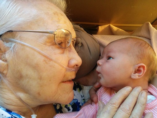 A photo capturing the heartwarming moment a 92-year-old held her baby great-granddaughter for the first time