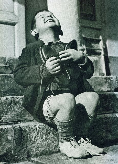 Austrian boy receives new shoes during WW2