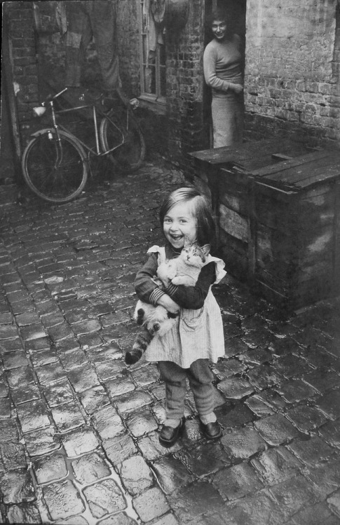 Happy French girl and her cat (1959).