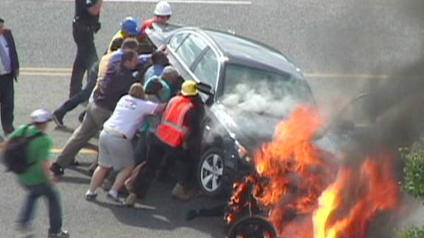 In 2011, a car crashed with a motorcycle, trapping the motorcyclist underneath the car. The wreck burst in to flames. Ignoring the fact that the wreck could explode at any second
