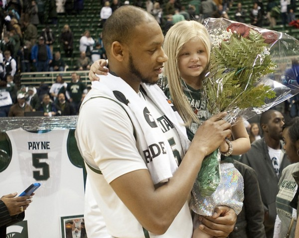 Michigan State player befriended 8 year old girl with tumor, carries her onto court as family member for his Senior Day ceremony because she could no longer walk