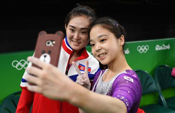 North Korean and South Korean gymnasts pose for selfie together in Rio