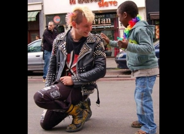 Punk rocker lets a little kid touch his spiked jacket