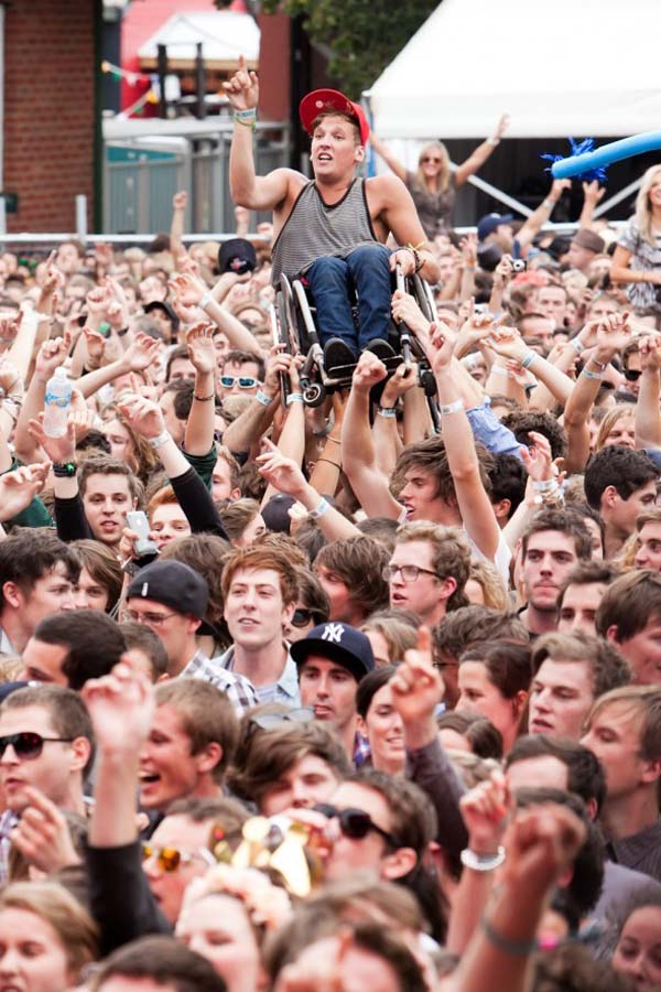 This crowd helped a young man in a wheelchair crowd surf.