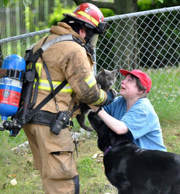 This firefighter risked his life to save one woman's beloved cat.