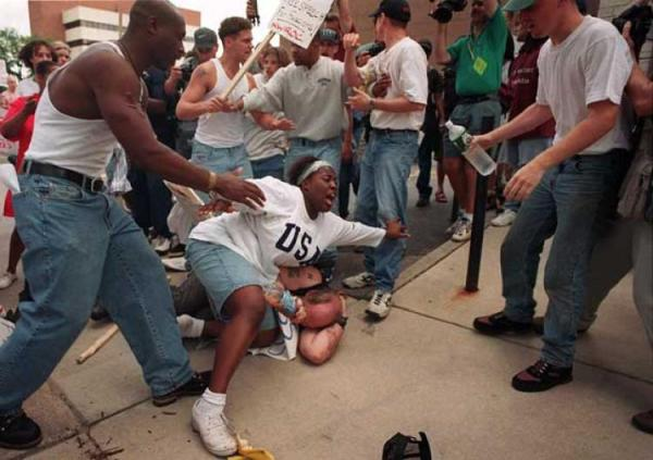 This is an 19 year old University of Michigan student putting herself between a mob and a klansman.