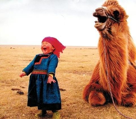 This photo of a Mongolian girl and her camel is full of joy.