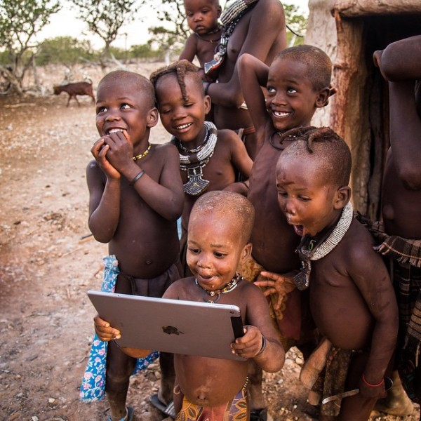 tribal children seeing an iPad for the first time. The expressions on all theirs faces just brings a huge smile to my face.