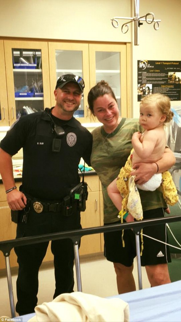 Reunited: Tammy Norvell, little Bexley and Officer Ray are pictured together in the hospital after the girl's close call