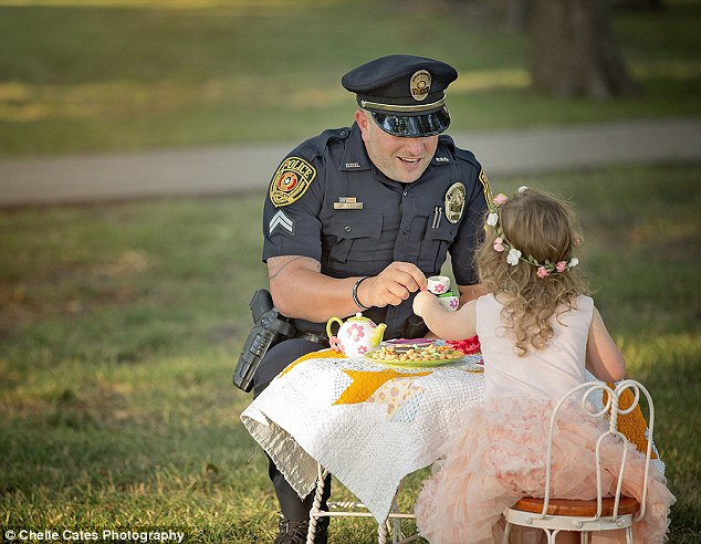 Best of friends: Bexley and Corporal Ray enjoyed some imaginary tea and real cookies in a bucolic setting