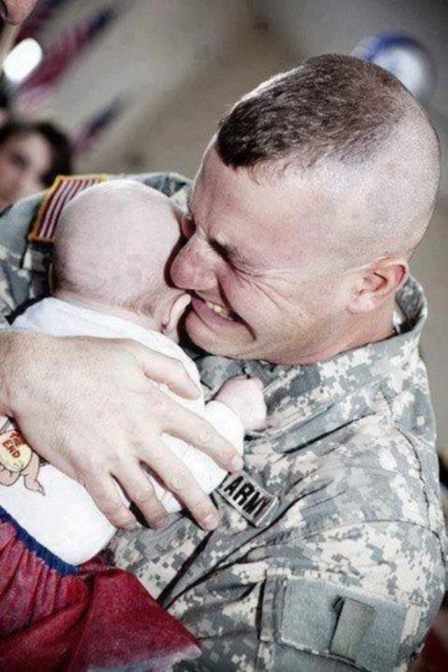 A touching moment. A U.S. Army soldier meeting his baby for the first time, after returning from Iraq.